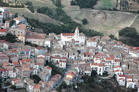 Oppido Lucano Veduta  aerea del paesotto che sorge su un'altura circondata da dolci colline di uliveti